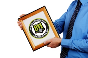 businessman holding certificate in a wood picture frame